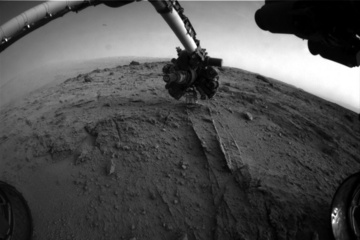 This image shows the view from NASA's Mars rover Curiosity after it uses an autonomous proximity placement technique to place its tool-laden robotic arm on a rock science target called 'Darwin' during the 399th Martian day, or sol, of its mission. Image released Sept. 23, 2013. Credit: NASA/JPL-Caltech